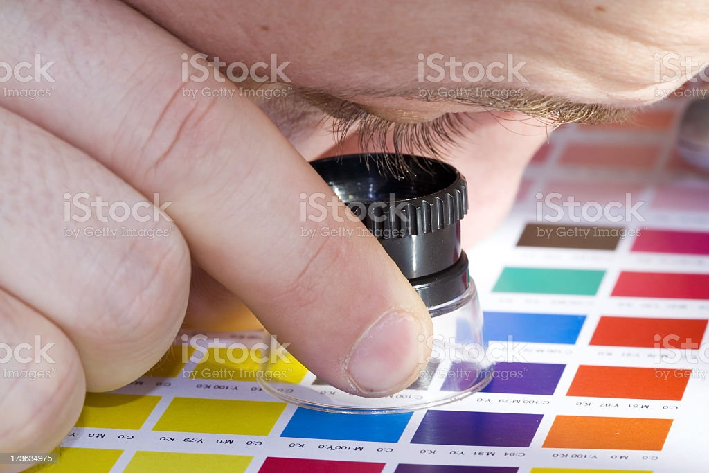 Graphic Designer and Magnifying Glass royalty-free stock photo