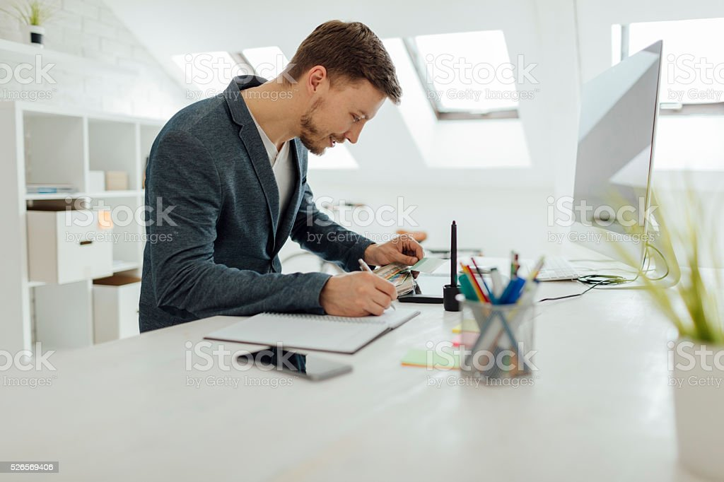 Male Interior Designers At Work graphic design studio pictures, images and stock photos - istock