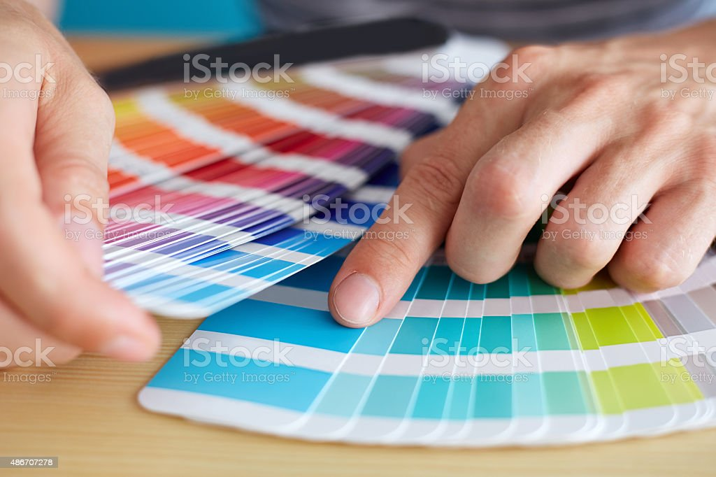 Graphic designer choosing a color stock photo