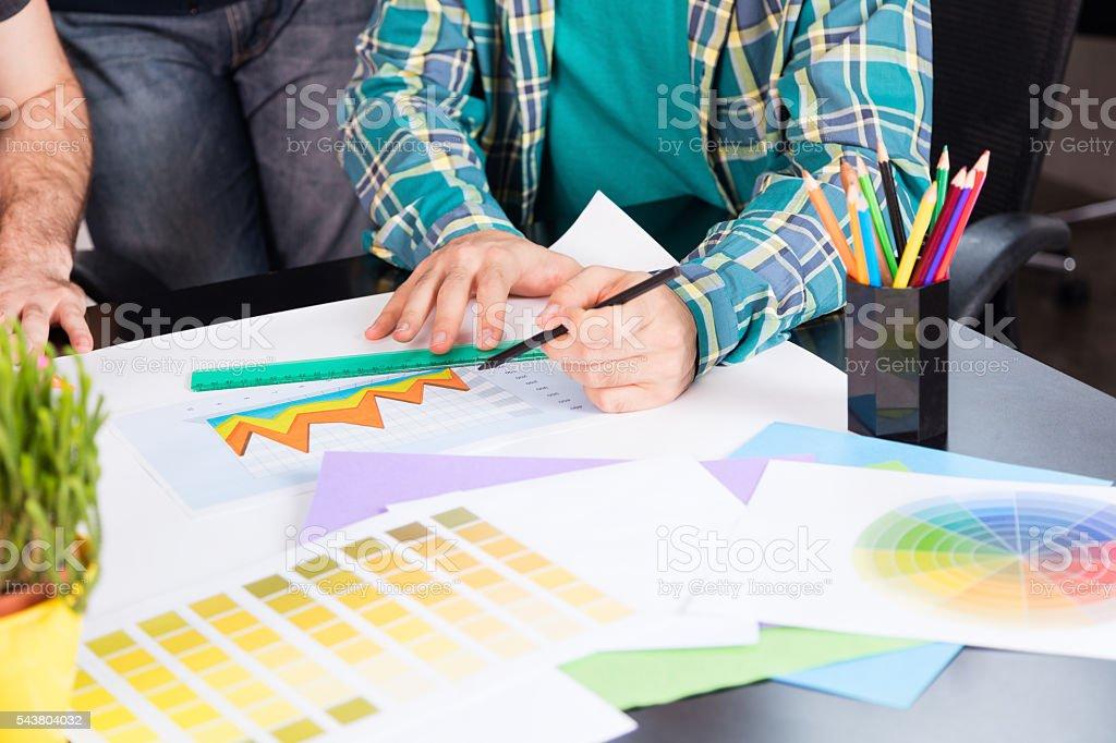 Graphic designer choosing color chart stock photo
