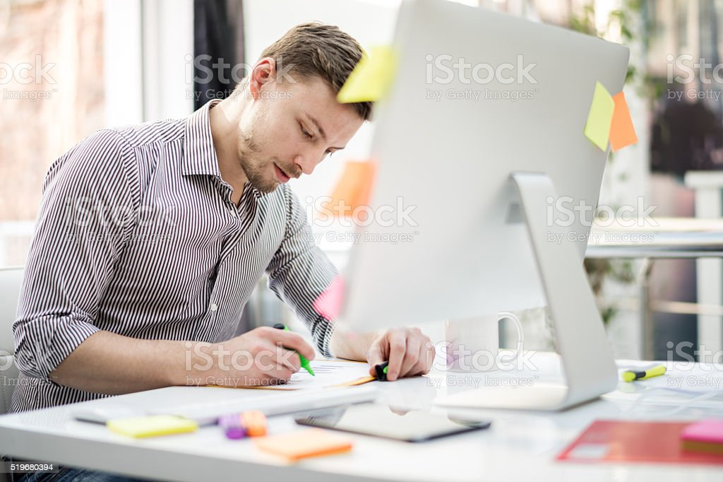 Graphic designer in the office stock photo