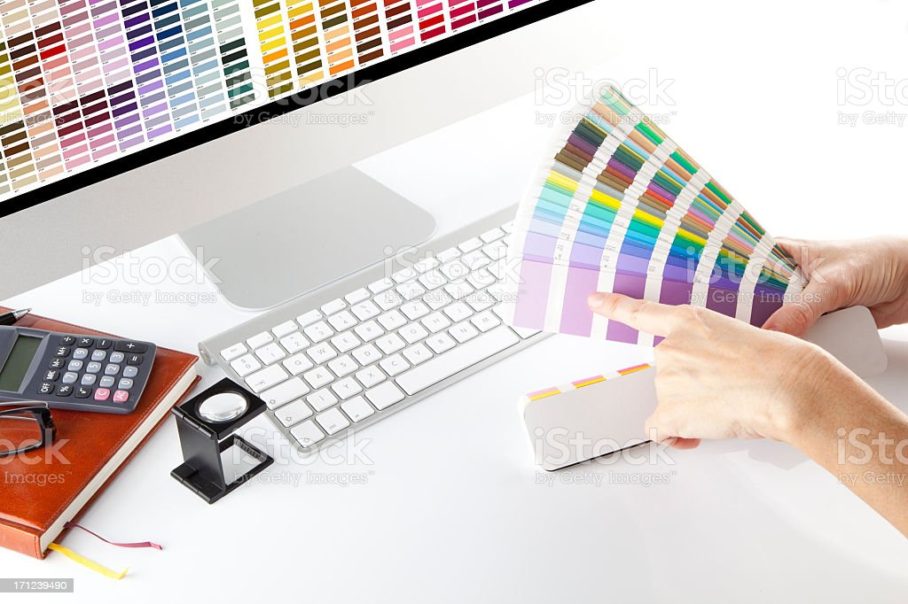 Graphic designer looking through color samples stock photo