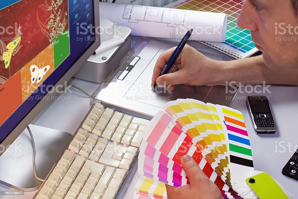 Graphic designer selects colors to project royalty-free stock photo