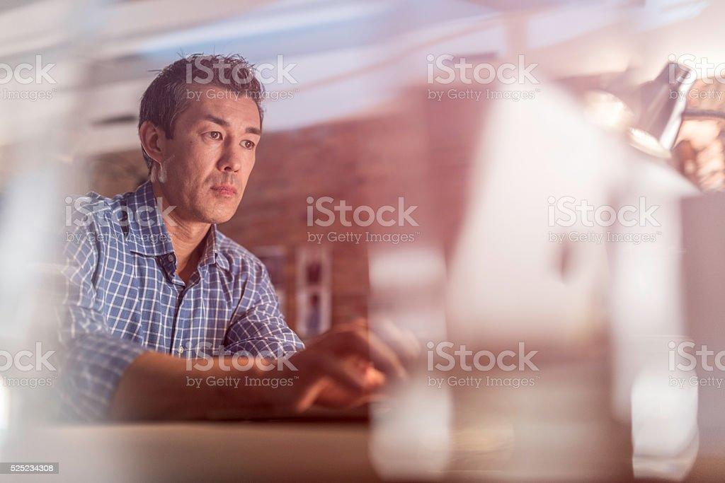 Graphic designer using a laptop stock photo