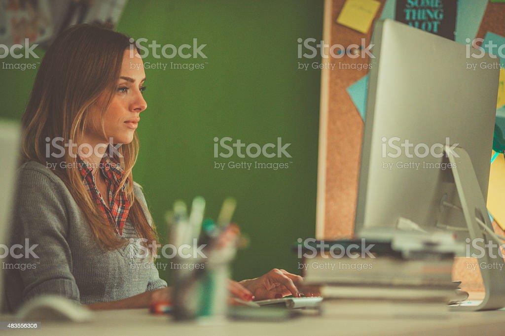Graphic designer using computer at work stock photo