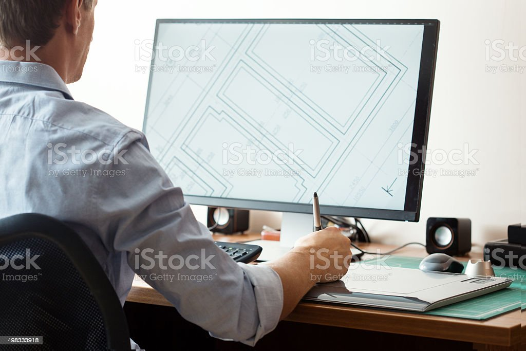 Graphic designer using digital tablet and computer in office or stock photo