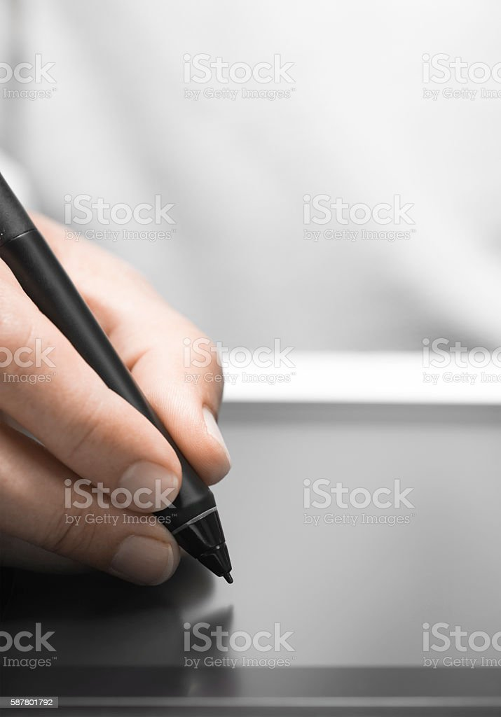 Graphic Designer Using Tablet and Stylus stock photo