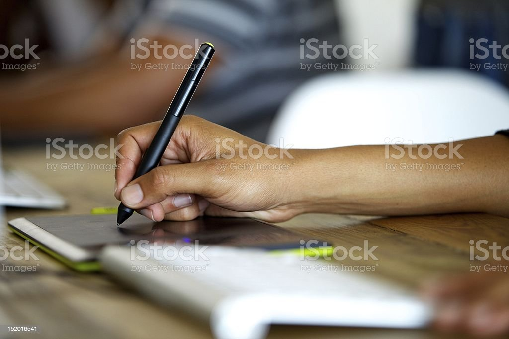 Graphic designer using tablet royalty-free stock photo