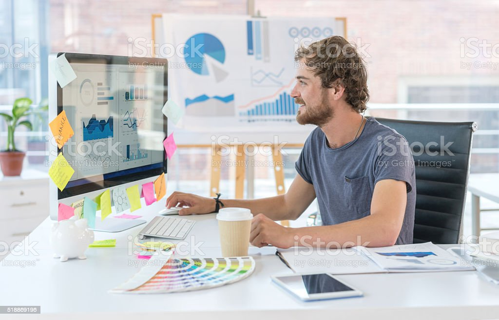 Graphic designer working at the office stock photo