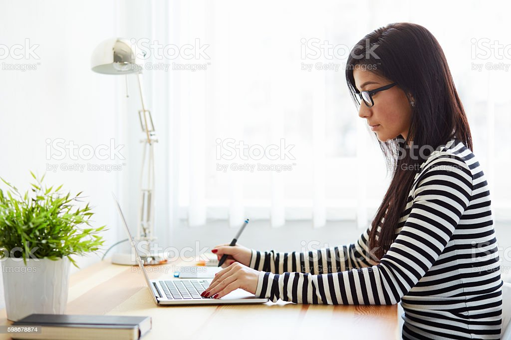 Graphic designer working on a digital tablet stock photo