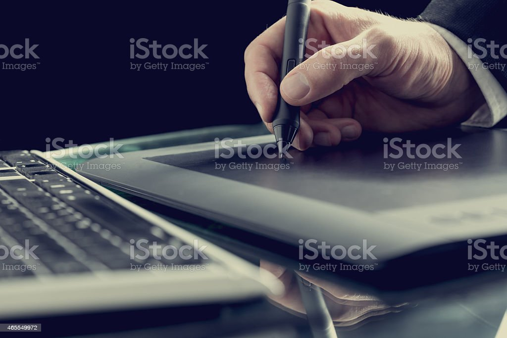Graphic designer working with digital tablet pen stock photo