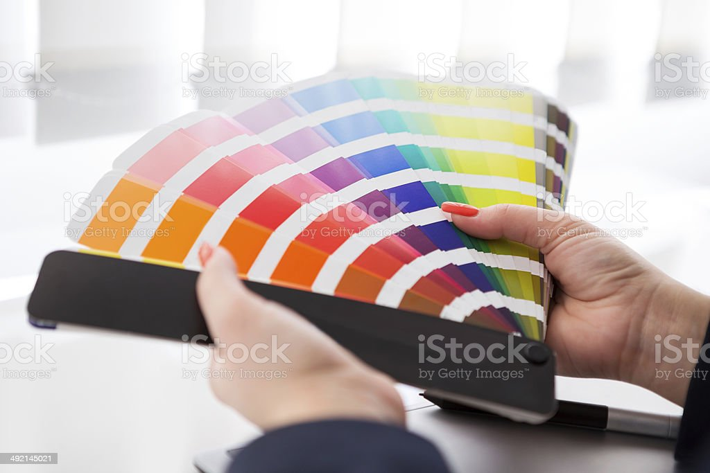 Graphic designer working with pantone palette stock photo