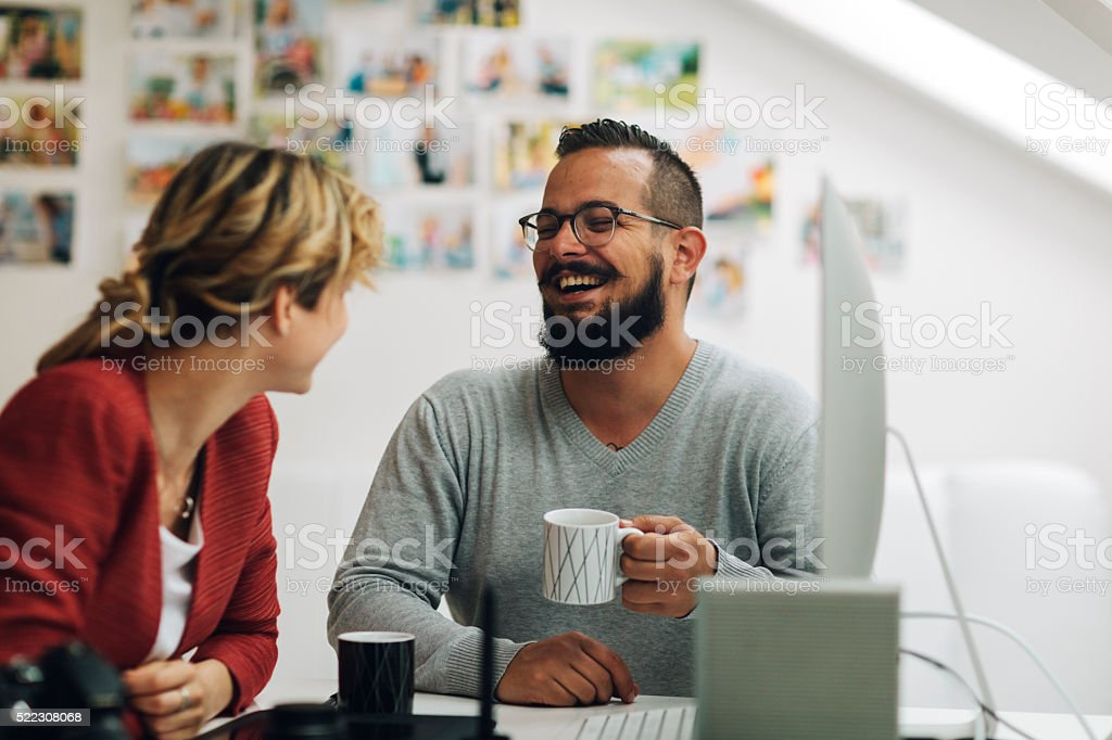 Graphic Designers Coffee Break At Work. stock photo