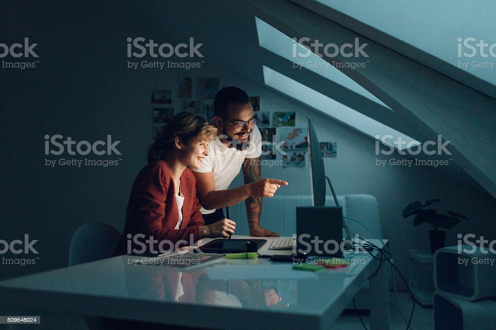 Graphic Designers Cooperating At Work stock photo