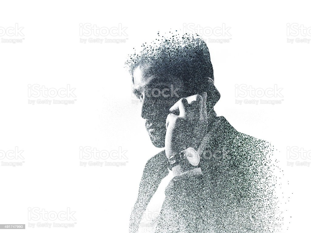 Graphic image of businessman on the phone created with dots stock photo