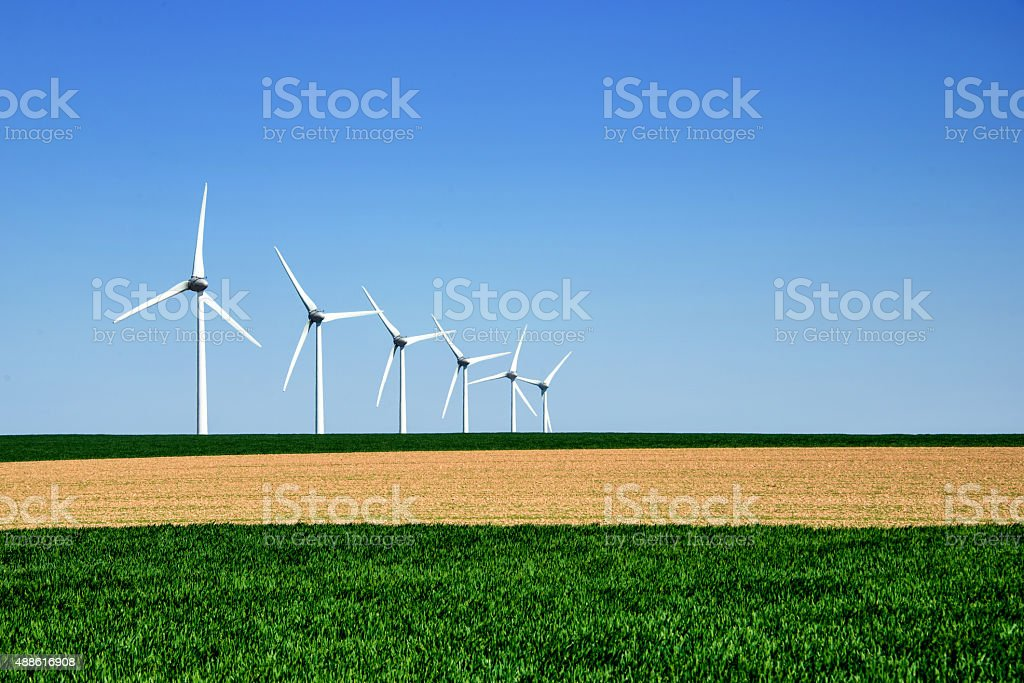 Graphic modern landscape of wind turbines stock photo