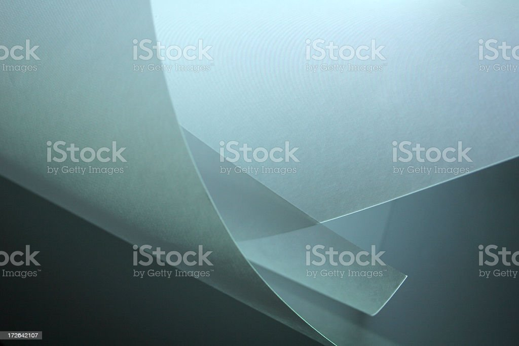 Graphic of curled edges of paper on gray stock photo