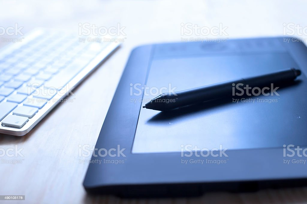 Graphic tablet with pen and keyboard stock photo