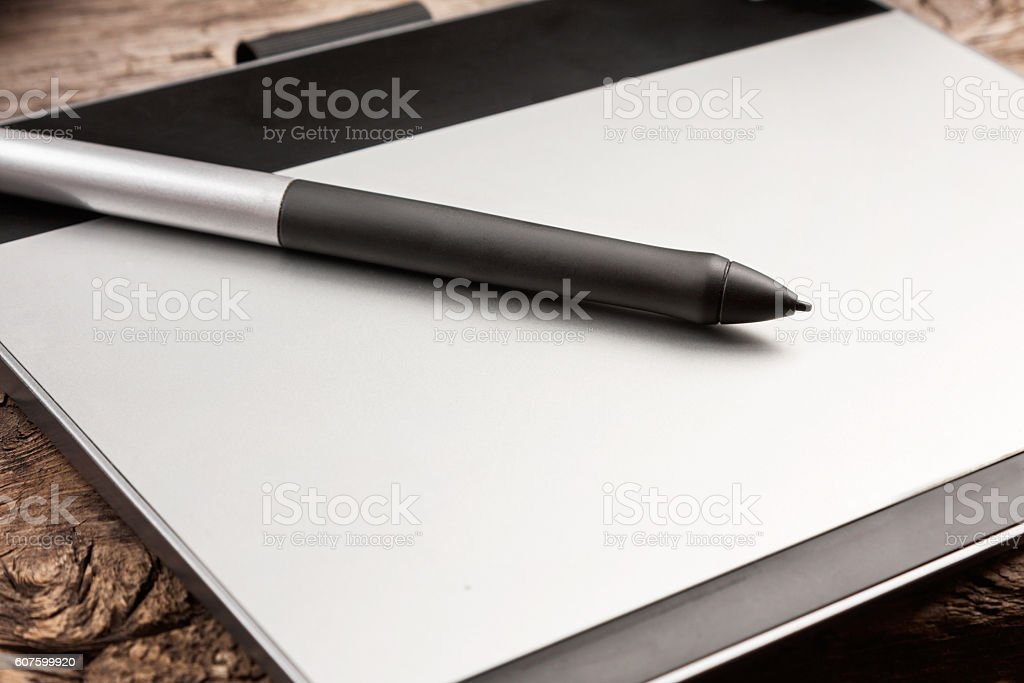 Graphic tablet with pen close-up shoot. stock photo