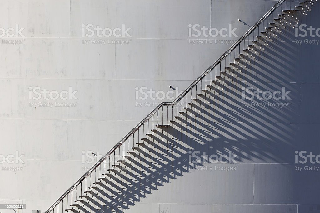 Graphical ladder on oil storage tank royalty-free stock photo
