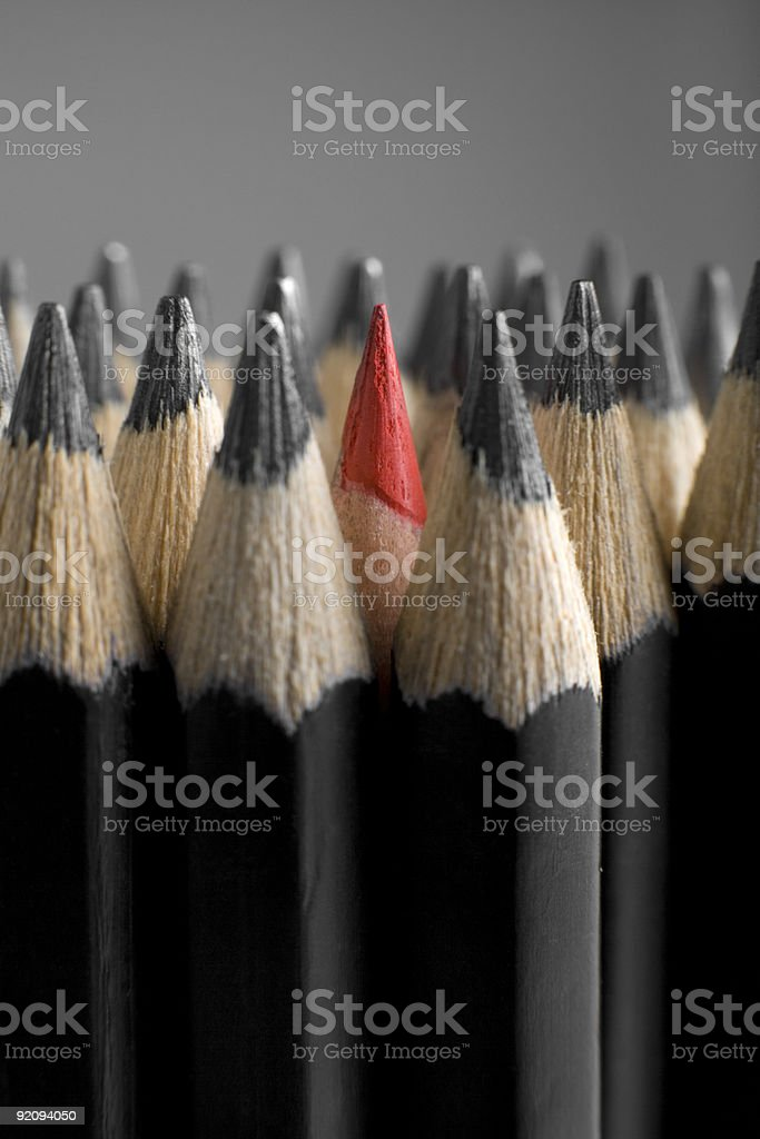 Graphite pencils in black with one in red stock photo