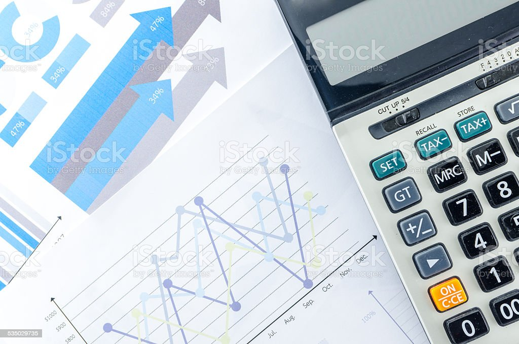 Graphs and Calculator stock photo
