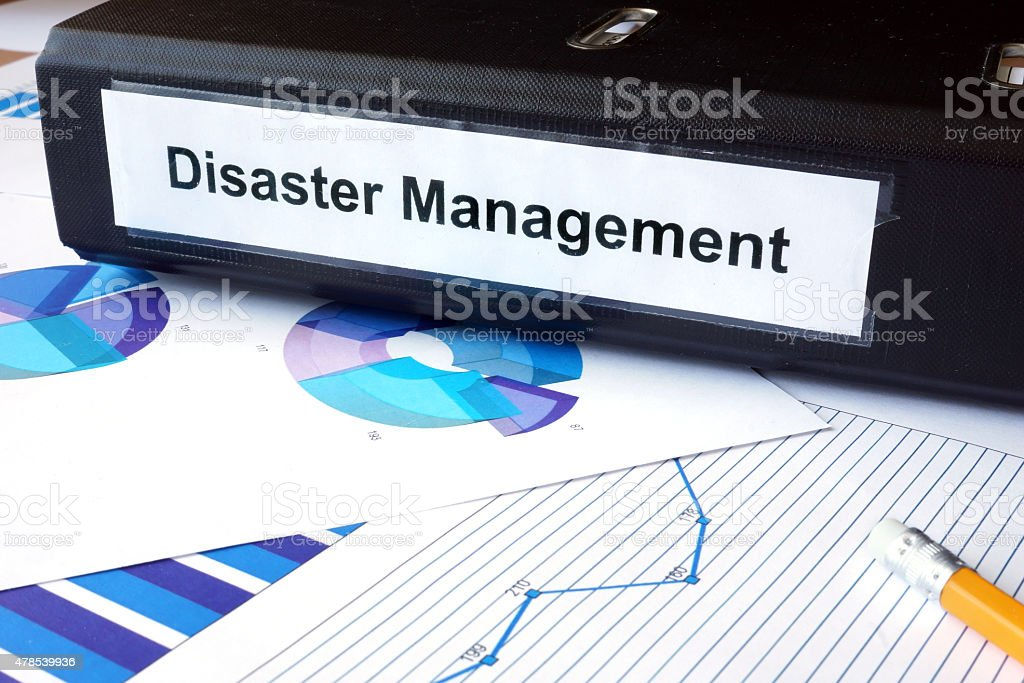 Graphs and file folder with label  Disaster Management. stock photo