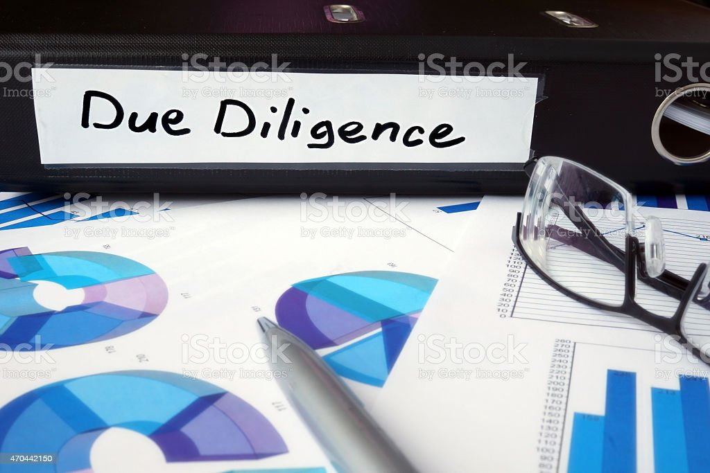 Graphs and file folder with label Due Diligence. stock photo