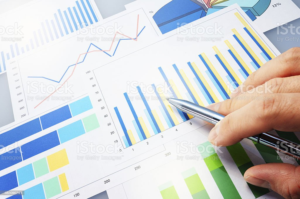 Graphs and pen. stock photo