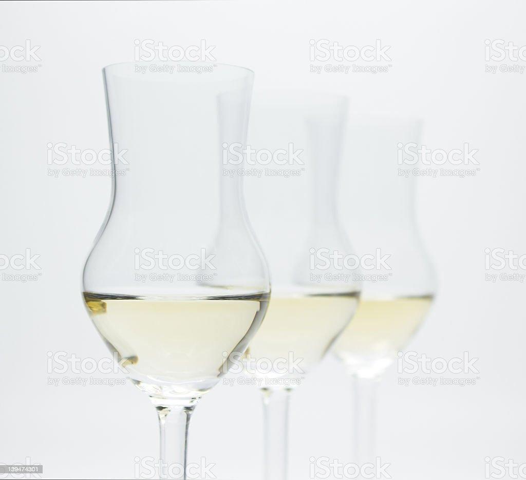 Grappa, Alcoholic Brandy, in 3 modern glasses stock photo