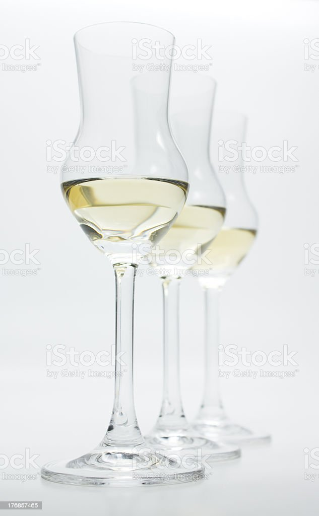 Grappa, Alcoholic Brandy, in 3 modern glasses stock photo