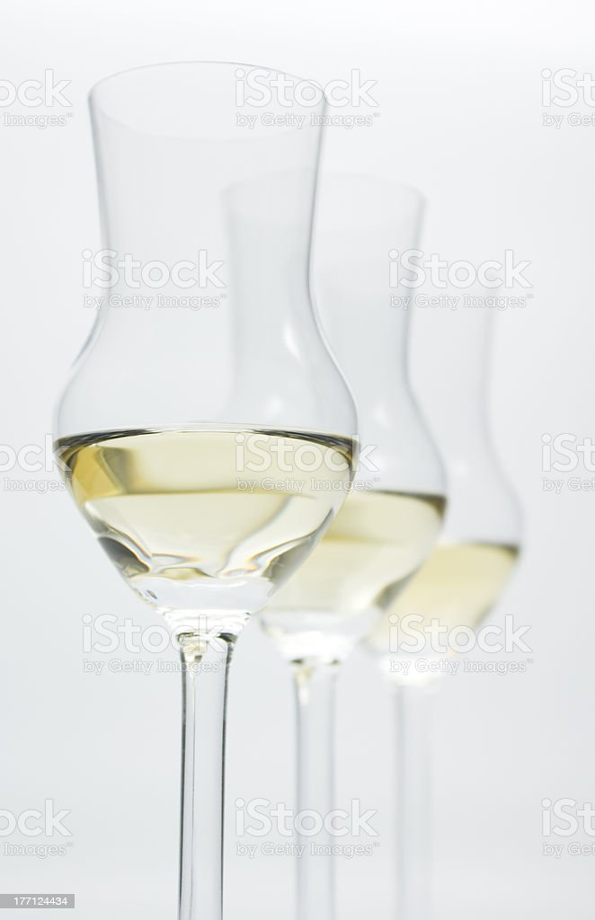 Grappa, Alcoholic Brandy, in 3 modern glasses royalty-free stock photo