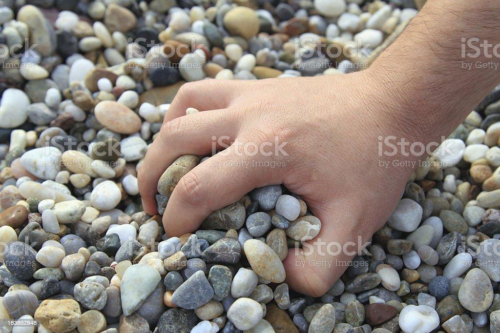 Grasp the Stones royalty-free stock photo
