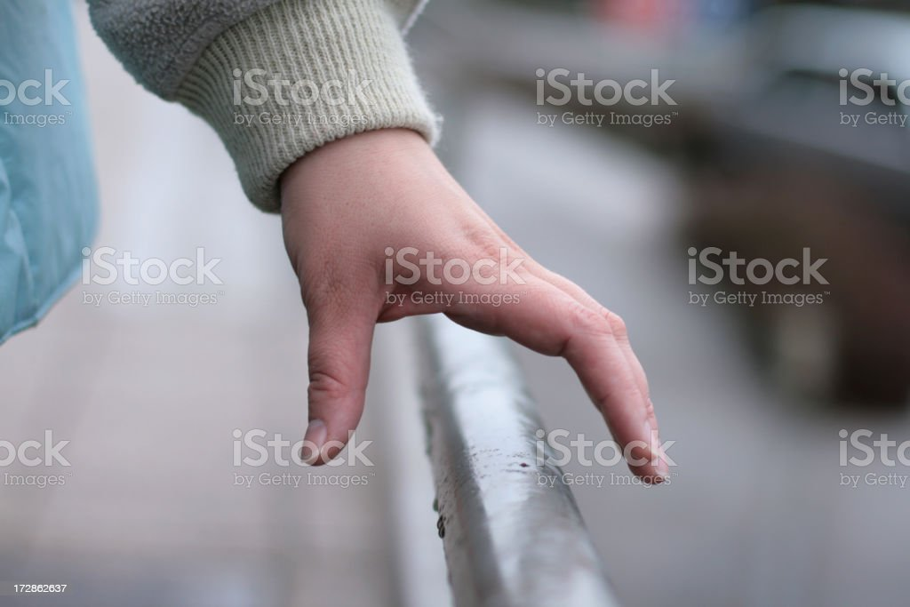 Grasping the hand railing stock photo