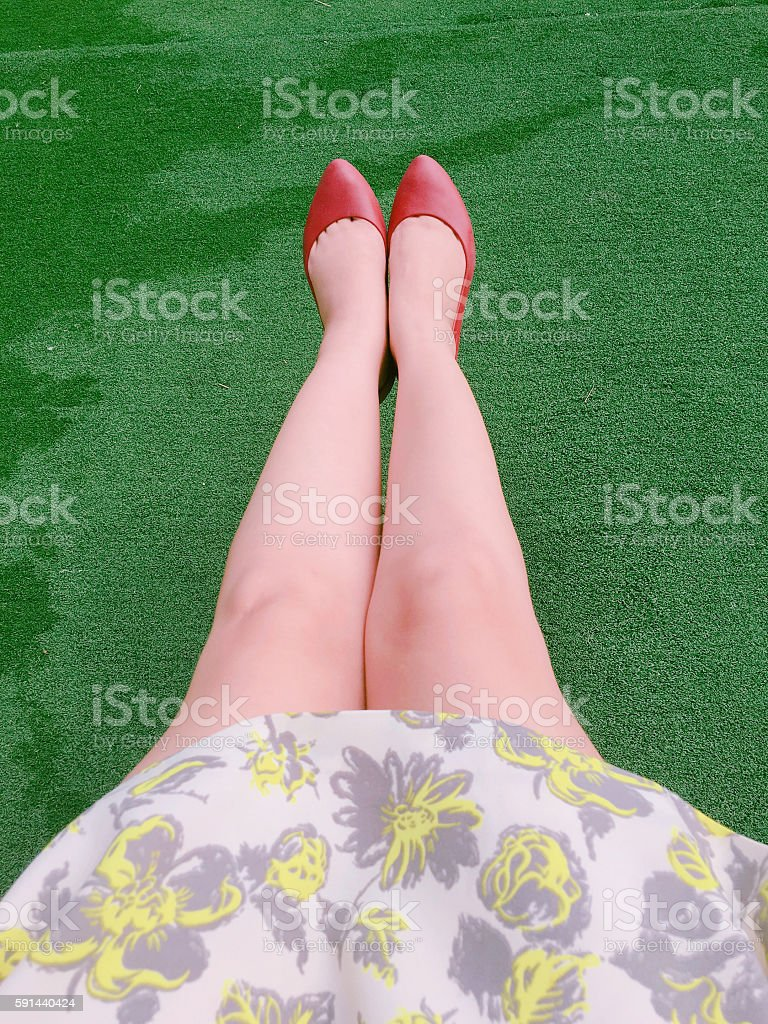 grass and red shoes stock photo
