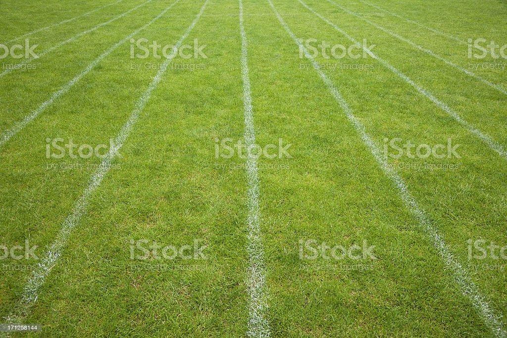 Grass athletics running track stock photo