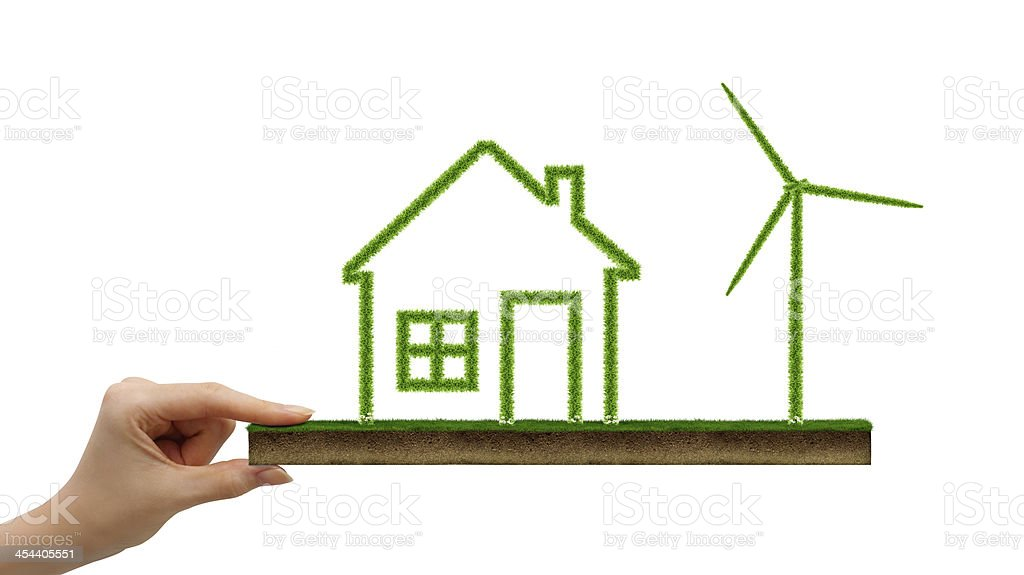 Grass covered house icon and wind turbine royalty-free stock photo