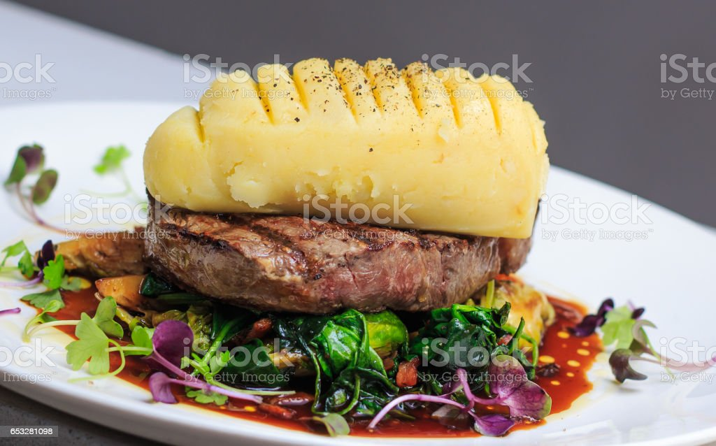 Grass Fed scotch fillet with mustard mash, brussels sprouts stock photo
