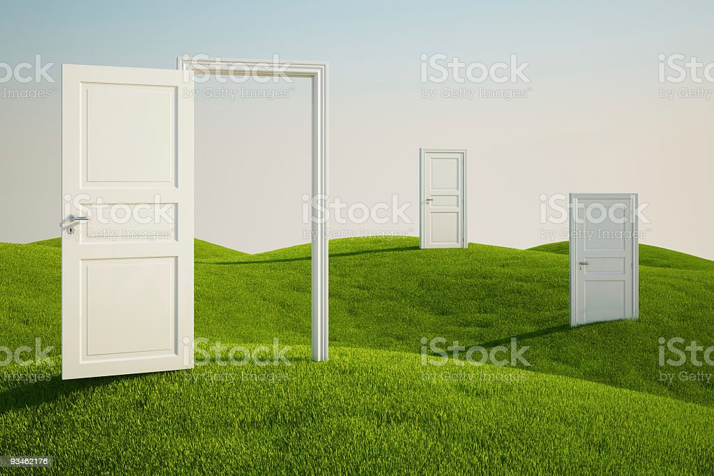Grass field with doors stock photo