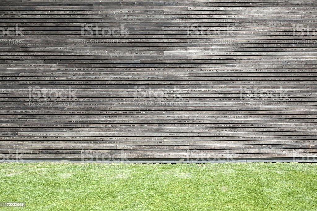 Grass floor and wooden cladding stock photo