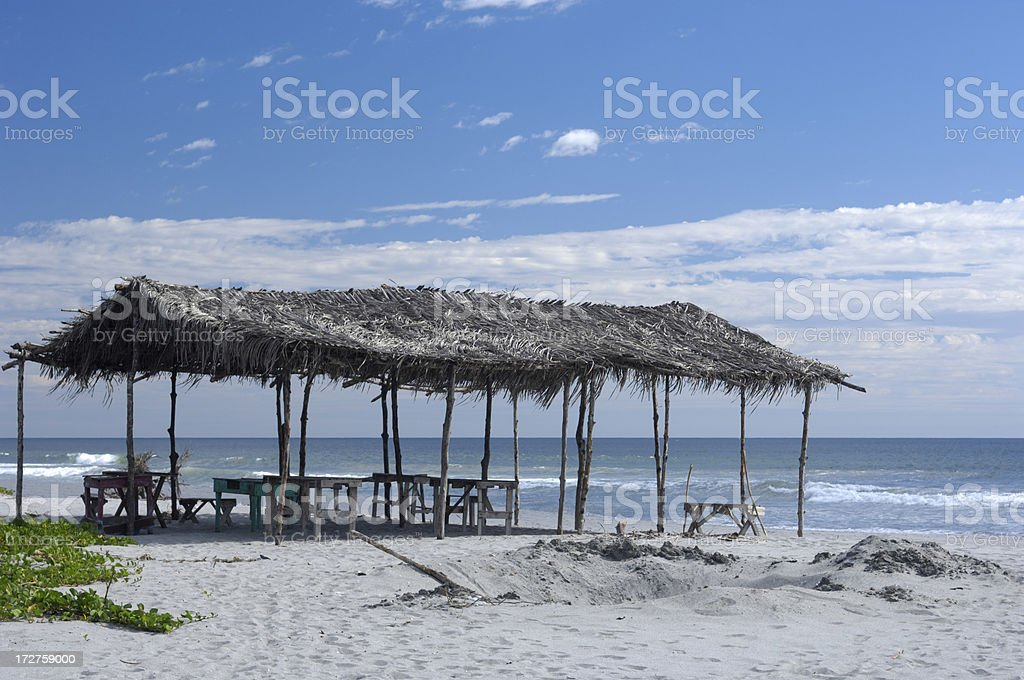 Grass Hut on Beach stock photo
