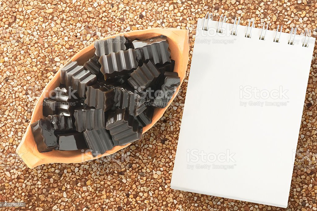Grass jelly and an empty notepad stock photo