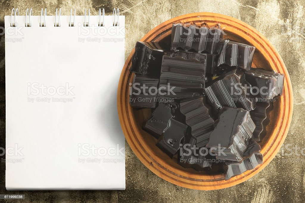 Grass jelly and empty notepad on grunged concrete stock photo