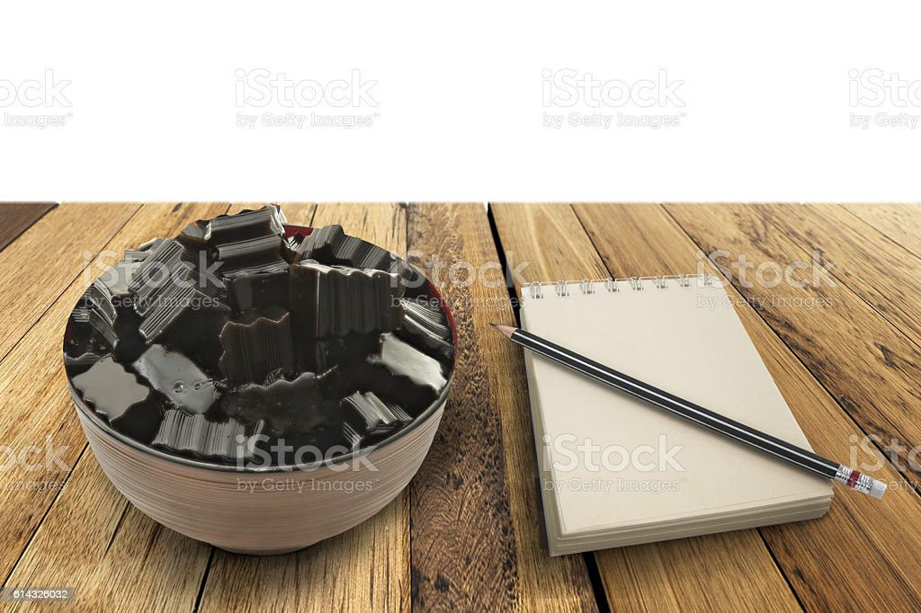 Grass jelly and empty notepad on wooden top stock photo