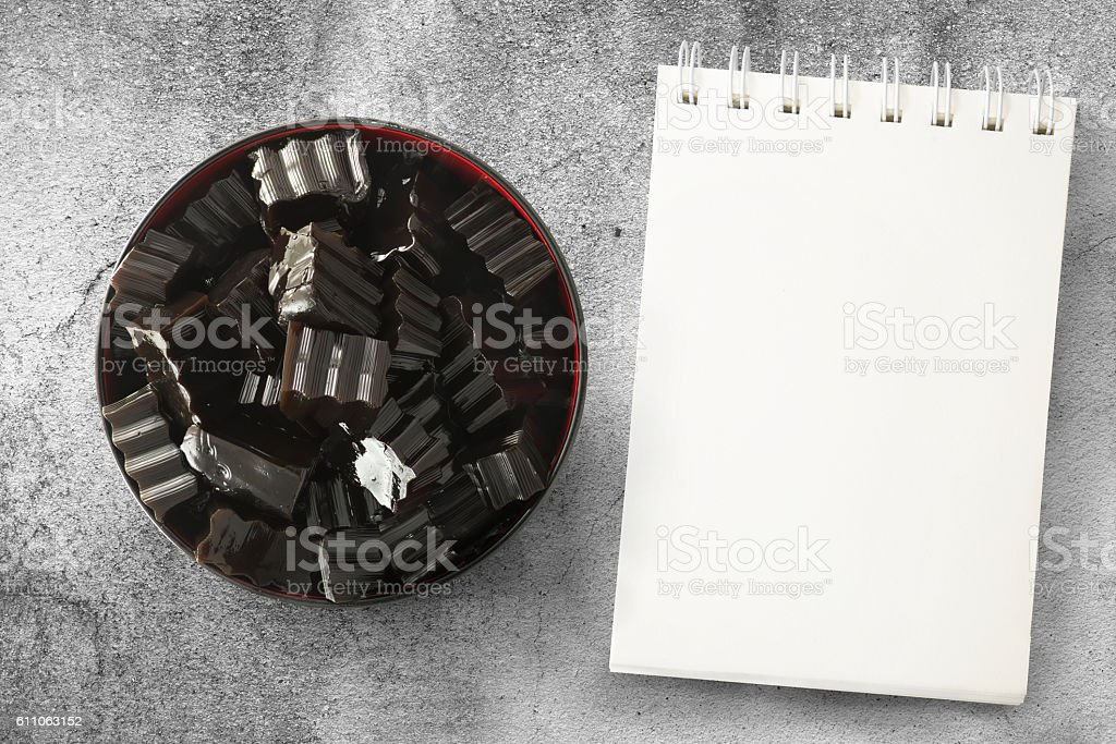Grass jelly and notepad stock photo