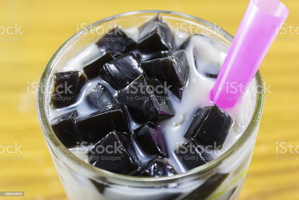 grass jelly in glass stock photo