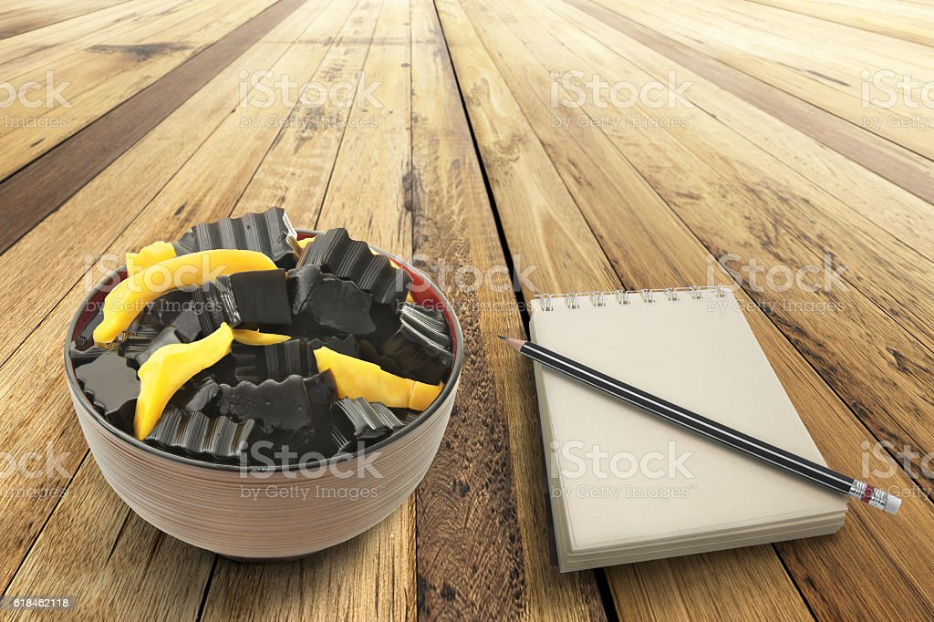 Grass jelly mixed with Jackfruit and empty notepad stock photo