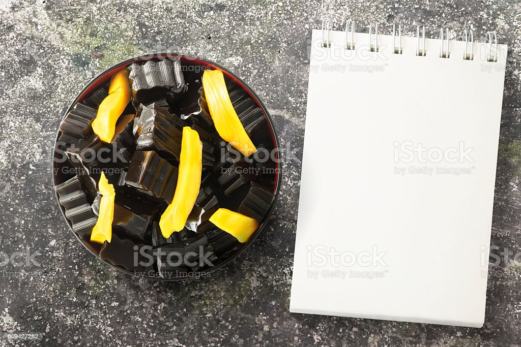 Grass jelly over grunged background stock photo