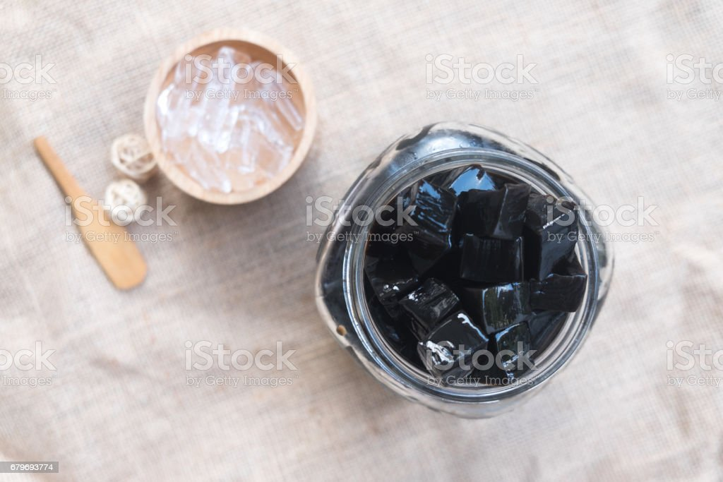 Grass jelly (Mesona chinensis), vegetable jelly, eaten with ice and sugar stock photo