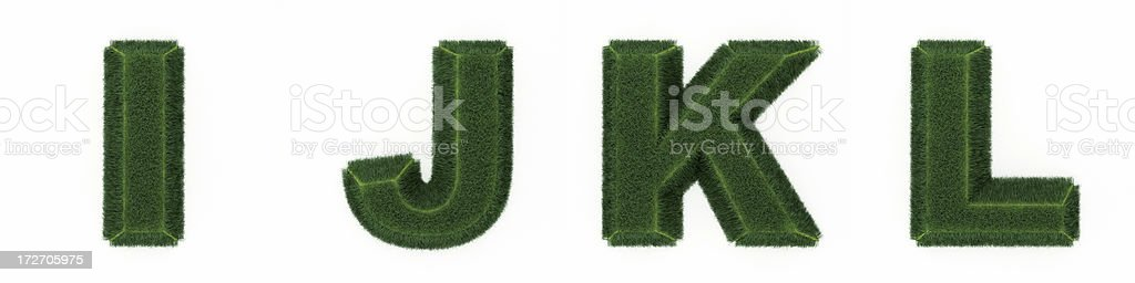 Grass letters IJKL royalty-free stock photo